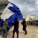 The Buxton Opera House crew lifting a giant blue head and moving it to a container at Longcliffe Quarries
